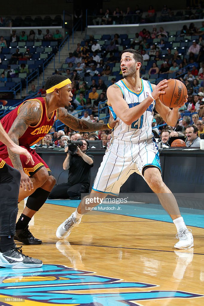 <a gi-track='captionPersonalityLinkClicked' href=/galleries/search?phrase=Greivis+Vasquez&family=editorial&specificpeople=4066977 ng-click='$event.stopPropagation()'>Greivis Vasquez</a> #21 of the New Orleans Hornets looks to pass the ball against <a gi-track='captionPersonalityLinkClicked' href=/galleries/search?phrase=Daniel+Gibson&family=editorial&specificpeople=213906 ng-click='$event.stopPropagation()'>Daniel Gibson</a> #1 of the Cleveland Cavaliers on March 31, 2013 at the New Orleans Arena in New Orleans, Louisiana.