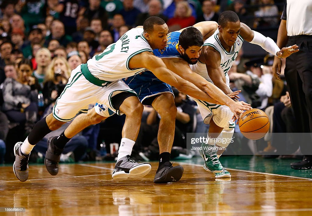 Greivis Vasquez #21 of the New Orleans Hornets scrambles for the ball in between Avery Bradley #0 and Rajon Rondo #9 of the Boston Celtics during the game on January 16, 2013 at TD Garden in Boston, Massachusetts.