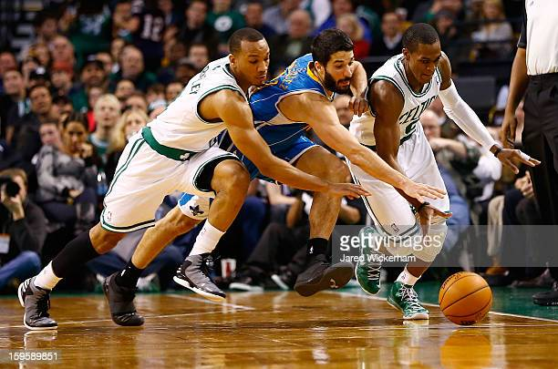 Greivis Vasquez of the New Orleans Hornets scrambles for the ball in between Avery Bradley and Rajon Rondo of the Boston Celtics during the game on...