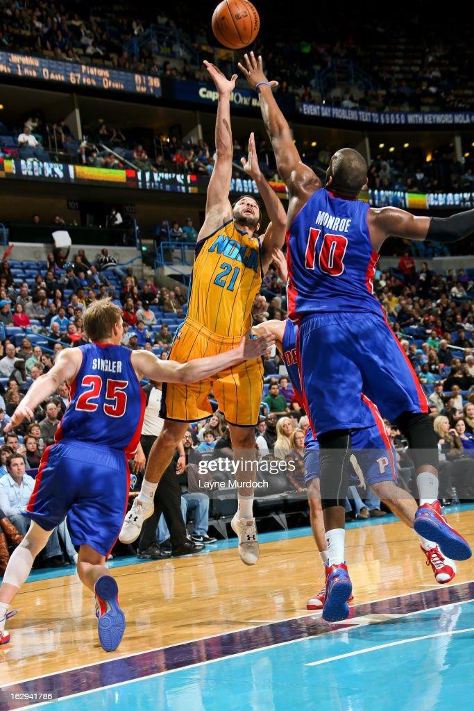 Greivis Vasquez #21 of the New Orleans Hornets shoots against Greg Monroe #10 of the Detroit Pistons on March 1, 2013 at the New Orleans Arena in New Orleans, Louisiana.