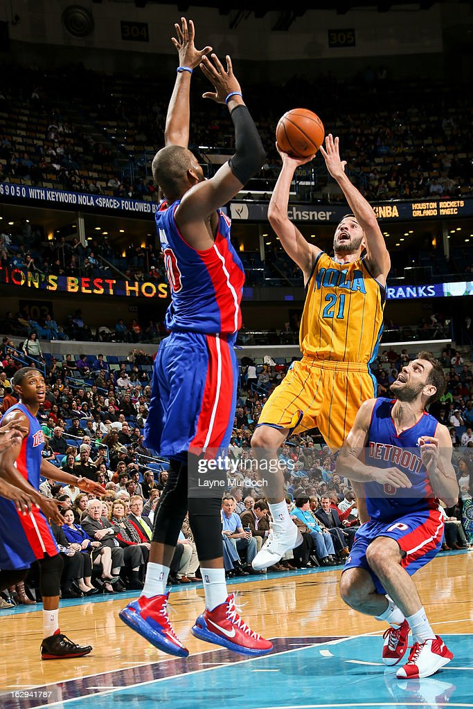 Greivis Vasquez #21 of the New Orleans Hornets shoots against Jose Calderon #8 and Greg Monroe #10 of the Detroit Pistons on March 1, 2013 at the New Orleans Arena in New Orleans, Louisiana.