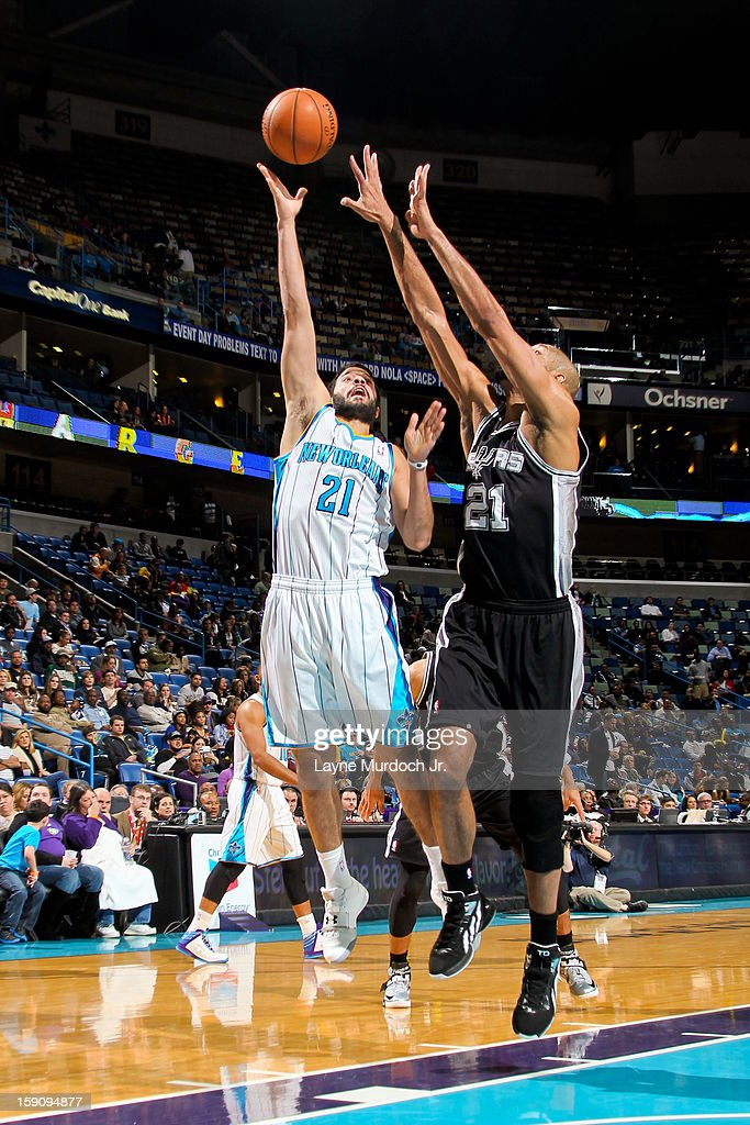 Greivis Vasquez #21 of the New Orleans Hornets shoots against <a gi-track='captionPersonalityLinkClicked' href=/galleries/search?phrase=Tim+Duncan&family=editorial&specificpeople=201467 ng-click='$event.stopPropagation()'>Tim Duncan</a> #21 of the San Antonio Spurs on January 7, 2013 at the New Orleans Arena in New Orleans, Louisiana.