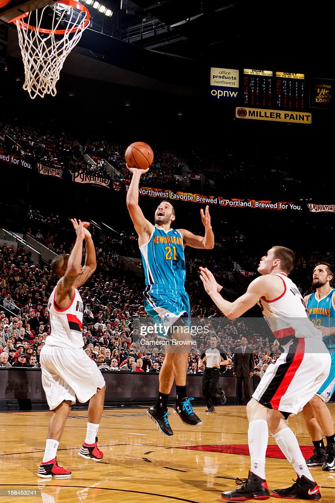 <a gi-track='captionPersonalityLinkClicked' href=/galleries/search?phrase=Greivis+Vasquez&family=editorial&specificpeople=4066977 ng-click='$event.stopPropagation()'>Greivis Vasquez</a> #21 of the New Orleans Hornets shoots in the lane against <a gi-track='captionPersonalityLinkClicked' href=/galleries/search?phrase=Luke+Babbitt&family=editorial&specificpeople=5122155 ng-click='$event.stopPropagation()'>Luke Babbitt</a> #8 of the Portland Trail Blazers on December 16, 2012 at the Rose Garden Arena in Portland, Oregon.