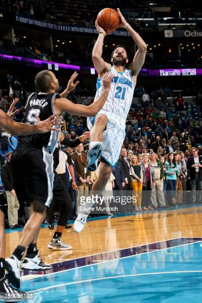 Greivis Vasquez of the New Orleans Hornets shoots in the lane against Tony Parker of the San Antonio Spurs on January 7 2013 at the New Orleans Arena...