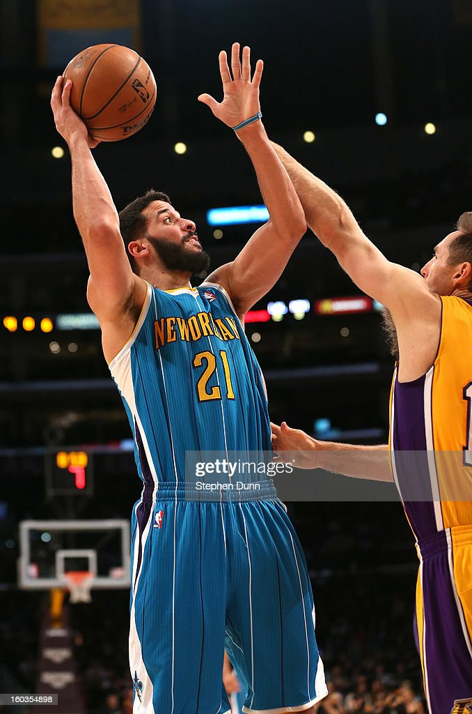 Greivis Vasquez #21 of the New Orleans Hornets shoots over Steve Nash #10 of the Los Angeles Lakers at Staples Center on January 29, 2013 in Los Angeles, California.