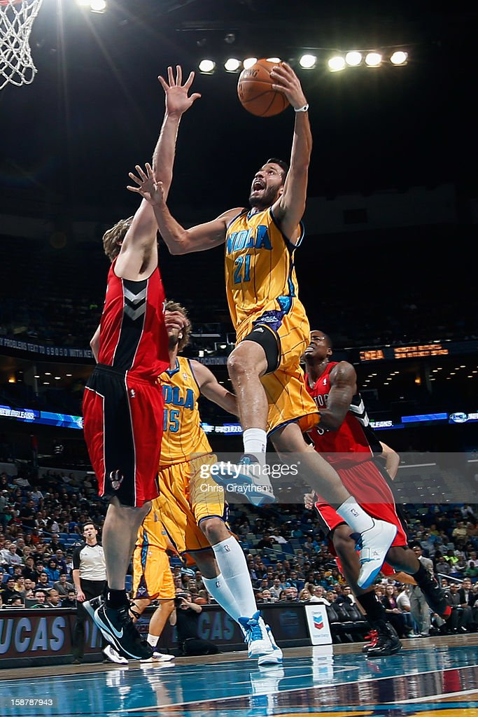 Greivis Vasquez #21 of the New Orleans Hornets shoots the ball over Aaron Gray #34 of the Toronto Raptors at New Orleans Arena on December 28, 2012 in New Orleans, Louisiana.