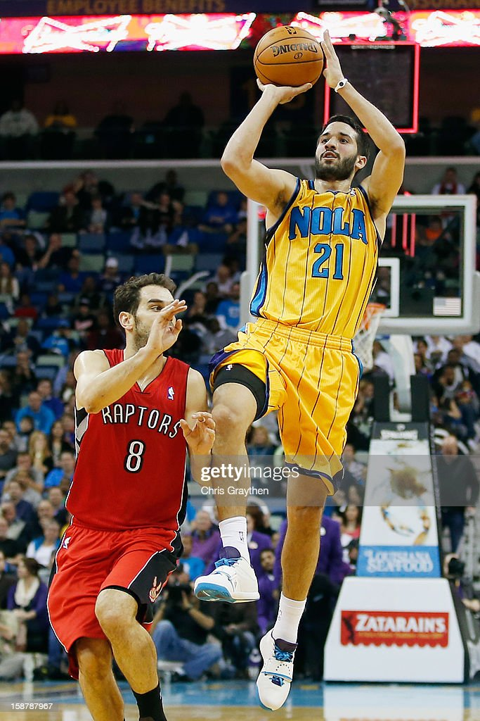 Greivis Vasquez #21 of the New Orleans Hornets shoots the ball over Jose Calderon #8 of the Toronto Raptors at New Orleans Arena on December 28, 2012 in New Orleans, Louisiana.