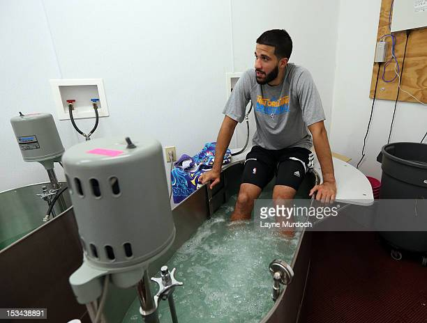 Greivis Vasquez of the New Orleans Hornets sits in the ice tub in training camp on October 4 2012 at the Alerio Center in Westwego Louisiana NOTE TO...