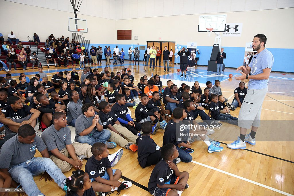 Greivis Vasquez #21 of the New Orleans Hornets speaks to children during an NBA/WNBA Fit Court Dedication and Clinic at the FBR branch of the Boys and Girls Clubs of Greater Washington on May 19, 2013 in Washington, DC.