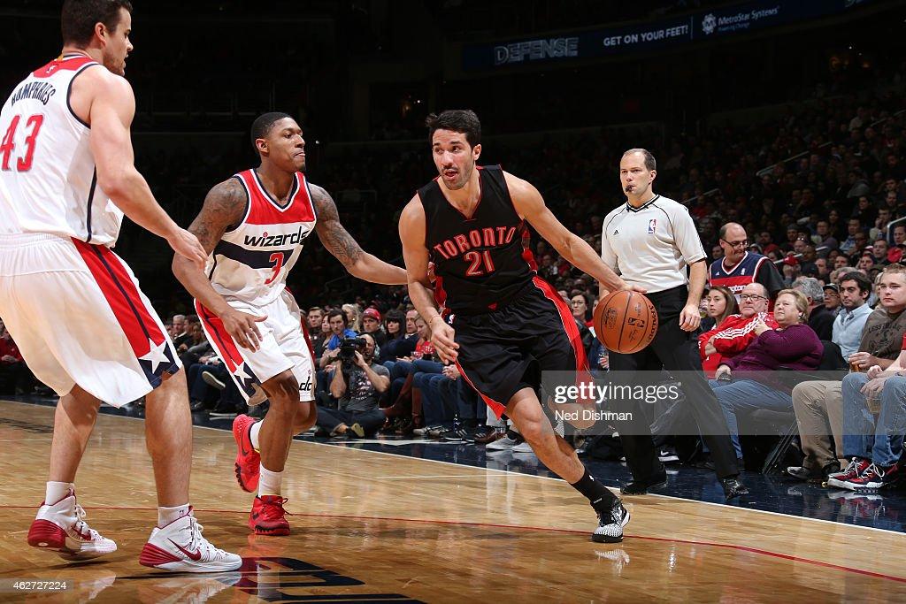 Greivis Vasquez #21 of the Toronto Raptors drives against Bradley Beal #3 of the Washington Wizards on January 31, 2015 at Verizon Center in Washington, DC.