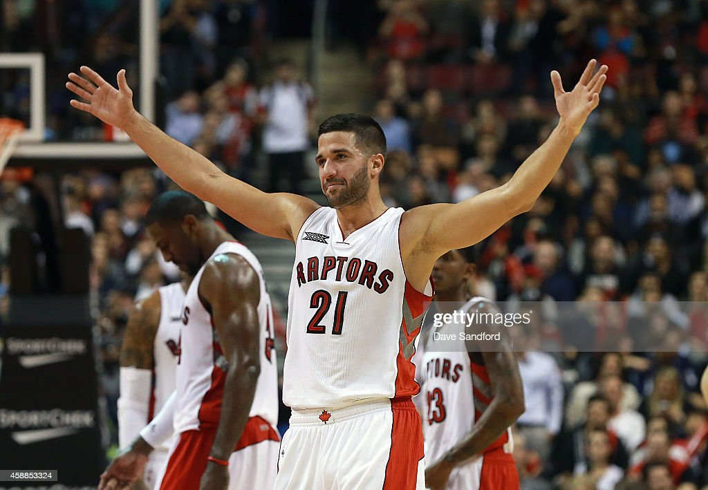 Greivis Vasquez of the Toronto Raptors raises his arms to prompt the crowd to make noise as his team faces the Oklahoma City Thunder during their...
