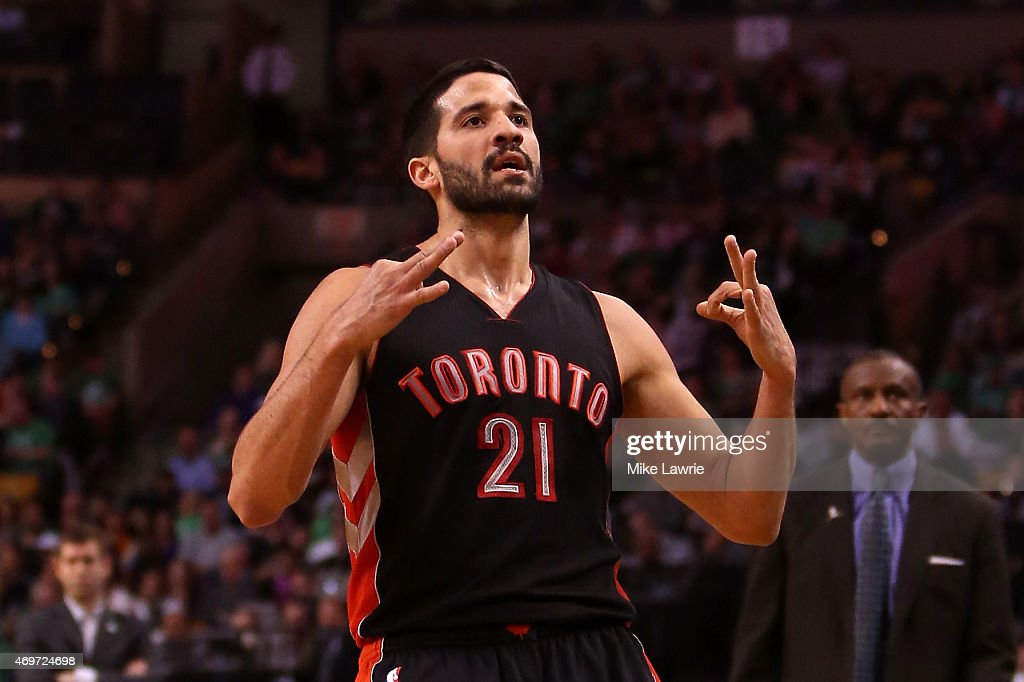 Greivis Vasquez of the Toronto Raptors reacts after making a three point basket in the first half against the Boston Celtics at TD Garden on April 14...