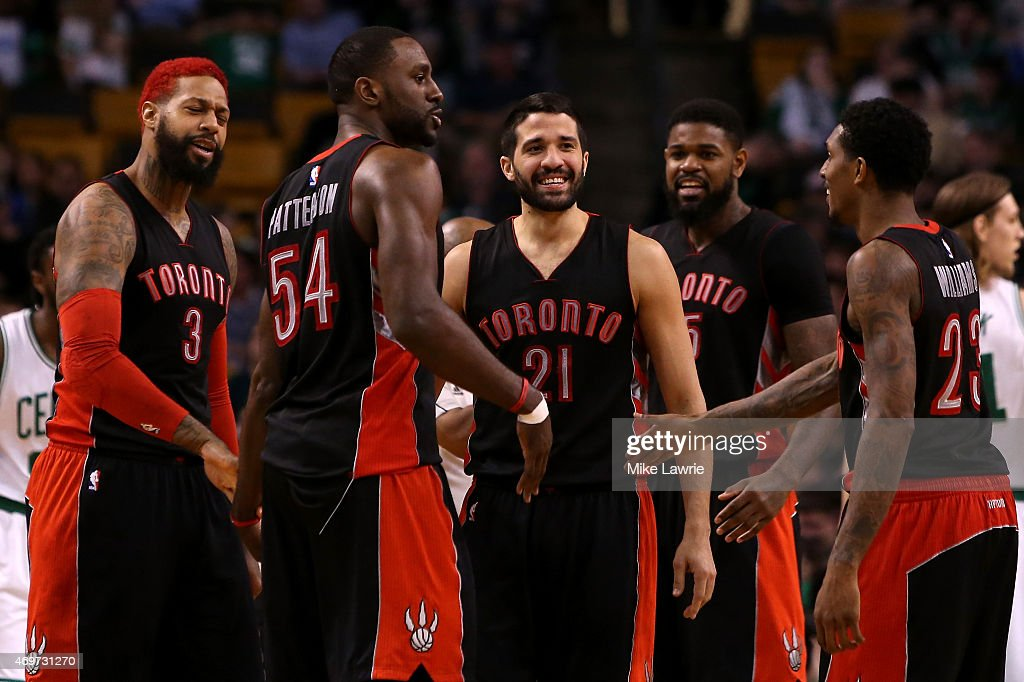 Greivis Vasquez #21 of the Toronto Raptors reacts with teammates James Johnson #3, Patrick Patterson #54, Amir Johnson #15 and Louis Williams #23 after a play at the start of the fourth quarter against the Boston Celtics at TD Garden on April 14, 2015 in Boston, Massachusetts.