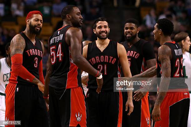 Greivis Vasquez of the Toronto Raptors reacts with teammates James Johnson Patrick Patterson Amir Johnson and Louis Williams after a play at the...