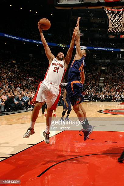 Greivis Vasquez of the Toronto Raptors shoots against the Phoenix Suns on November 24 2014 at the Air Canada Centre in Toronto Ontario Canada NOTE TO...
