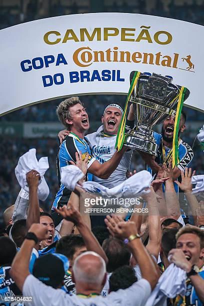 Gremio players celebrate winning the championship Brazil 2016 Cup at Arena do Gremio on December 07 2016 in Porto Alegre Brazil Gremio beat Atletico...