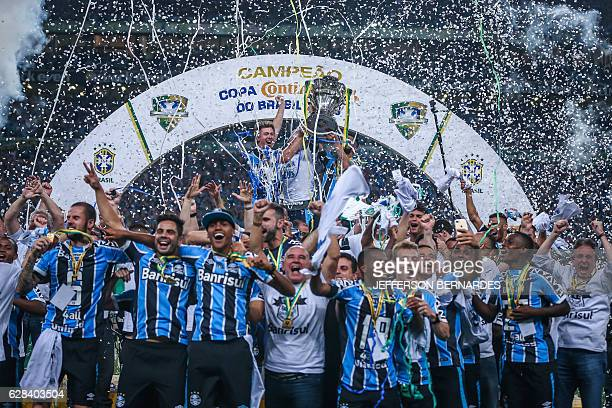 Gremio players celebrate with the Brazil Cup 2016 trophy after winning over Atletico Mineiro at Arena do Gremio in Porto Alegre Brazil on December 07...