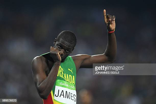 Grenada's Kirani James gestures after taking the silver in the Men's 400m Final during the athletics event at the Rio 2016 Olympic Games at the...