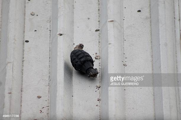 A grenade is seen at the roof of a house after a woman and three of her sons were killed in an attack where three houses were torched in Polixtepec...