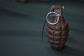 A grenade is seen on a table after being exchanged by their owners on January 04 2013 in Mexico City Mexico More than a thousand weapons have been...