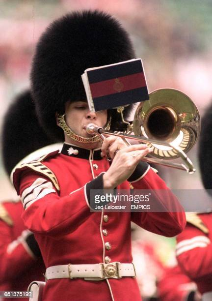 A Grenadier Guard concentrates on his fingerwork during the prematch entertainment