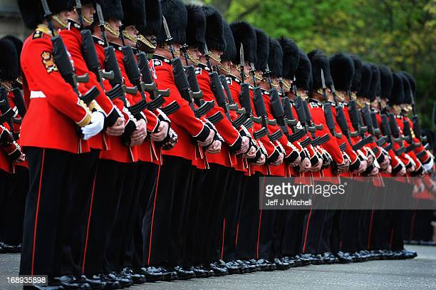 Grenadier Guards from No 2 Company 1st Battalion Grenadier Guards wait to be inspected by The Lord High Commissioner to the General Assembly Baron...