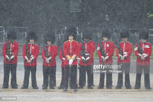 Grenadier Guards stand in the rain during the Colonel's Review the final rehearsal of Trooping the Colour the Queen's annual Birthday parade in...