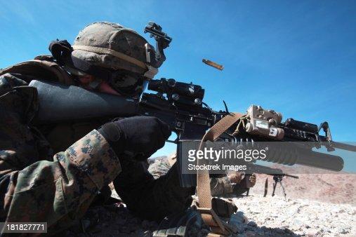 A grenadier provides suppressing fire during counter-ambush training.