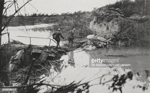 Grenadiers crossing the Sile on an improvised path Battle of Piave Italy World War I from l'Illustrazione Italiana Year XLV No 28 July 14 1918