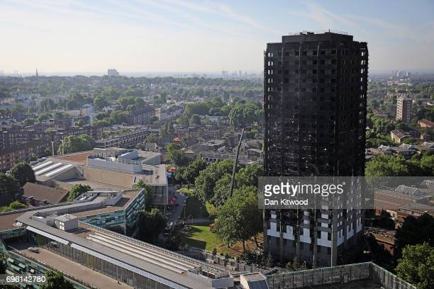 Grenfall tower continues to smoulder on June 15 2017 in London England At least twelve people have been confirmed dead and dozens missing after the...