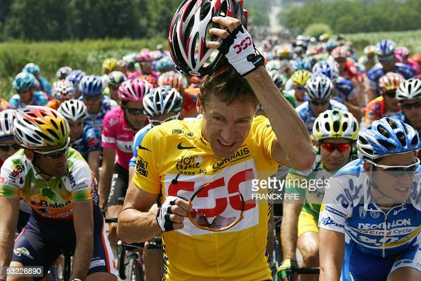 Yellow jersey German Jens Voigt takes off his helmet during the tenth stage of the 92nd Tour de France cycling race between Grenoble and Courchevel...