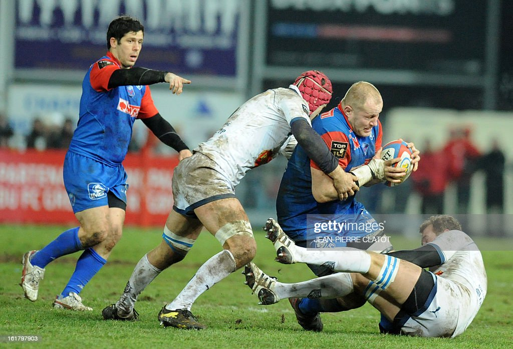 Grenoble's Australian lock Ben Hand (2ndR) vies with Agen's players during the French Top 14 rugby union match Grenoble vs Agen on february 16, 2013 at the Lesdiguieres Stadium in Grenoble, southeastern France.