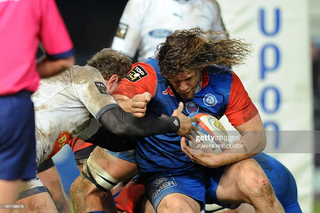 Grenoble's French flanker Fabien Alexandre tries to get through a tackle during the French Top 14 rugby union match Grenoble (FCG) vs Agen (SU) on February 16 , 2013 at the Stade Lesdiguieres in Grenoble. AFP PHOTO / Jean Pierre Clatot