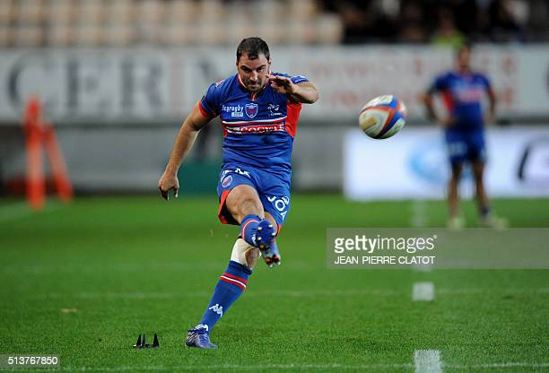 Grenoble's French flyhalf Jonathan Wisniewski hits a penalty kick during the French Top 14 rugby union match Grenoble vs Clermont Auvergne on march 4...