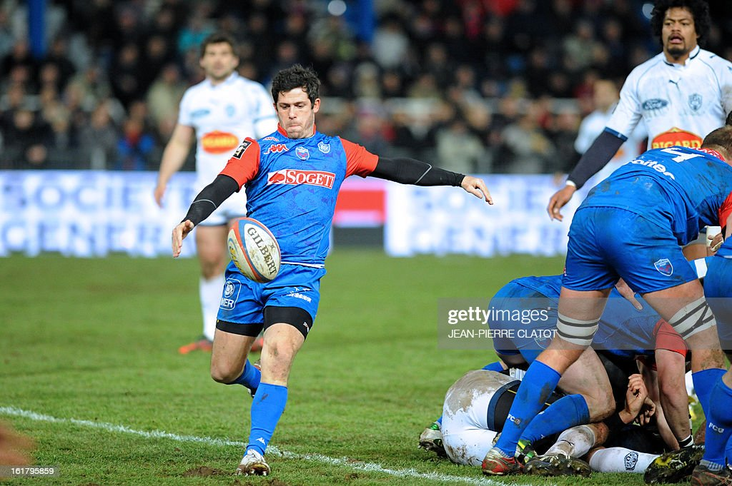Grenoble's French fly-half Valentin Courrent (L) clears the ball out of a scrum during the French Top 14 rugby union match Grenoble vs Agen on February 16, 2013 at the Lesdiguieres Stadium in Grenoble. AFP PHOTO / Jean Pierre Clatot