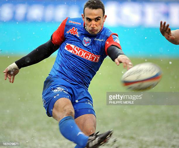 Grenoble's French fullback Fabien Gengenbacher kicks the ball during the French Top 14 rugby union match Grenoble vs Clermont Ferrand on February 23...