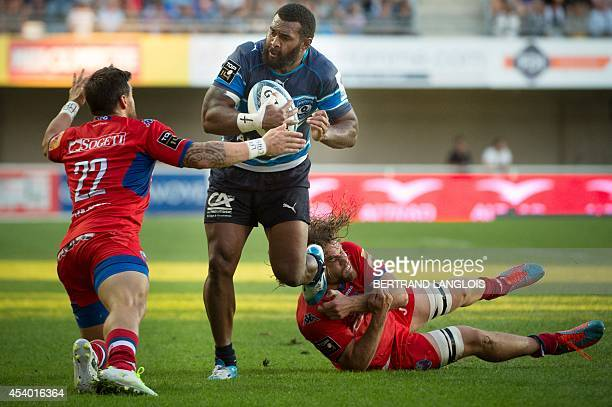 Grenoble's French winger Julien Caminati challenges Montpellier's fullback Timoci Nagusa during the French Top 14 rugby union match Montpellier vs...