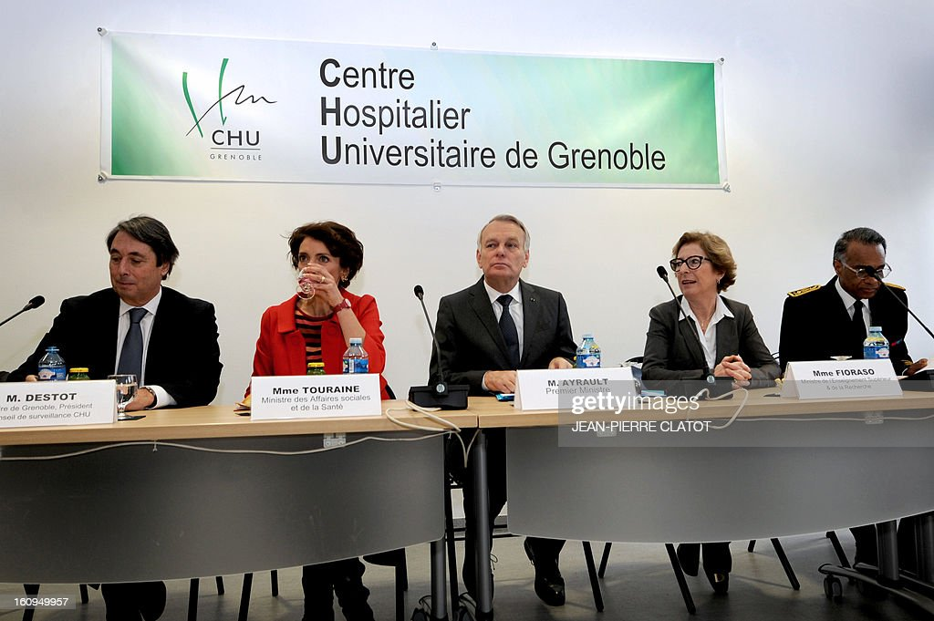 Grenoble's mayor and Socialist member of parliament Michel Destot, French Social Affairs and Health Minister, Marisol Touraine, French Prime Minister Jean-Marc Ayrault and French Minister for Higher Education and Research Genevieve Fioraso pose on February 8, 2013 prior to a meeting with members of a neurosurgery unit at the Couple Enfant Hospital in Grenoble.