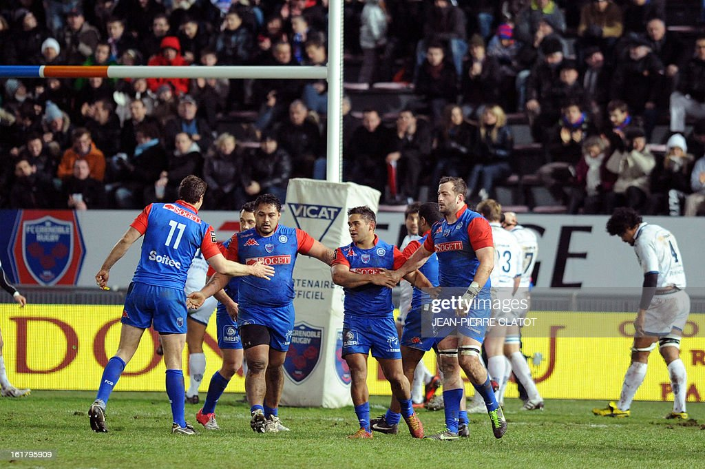 Grenoble's New-Zealander prop Dayna Edwards (2ndL) cheers with teammates after Grenoble scored a try during the French Top 14 rugby union match Grenoble vs Agen on february 16, 2013 at the Lesdiguieres Stadium in Grenoble, southeastern France. AFP PHOTO / JEAN-PIERRE CLATOT