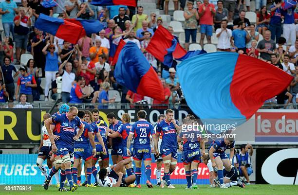 Grenoble's players react after a try during the French Top 14 rugby union match Grenoble vs Agen on August 22 2015 at the Stade des Alpes in Grenoble...