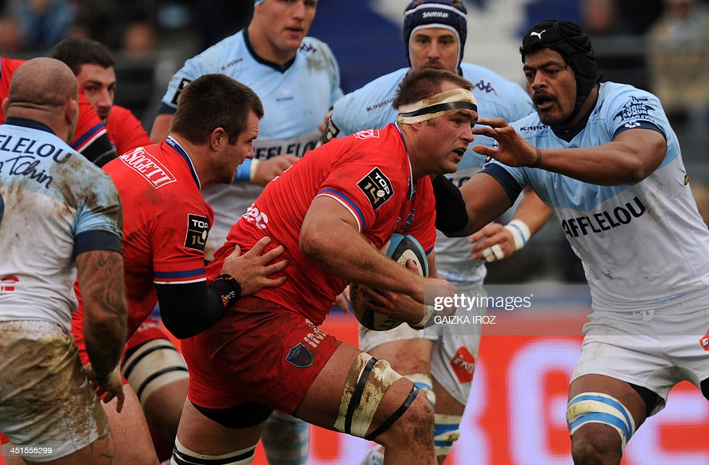 Grenoble's secondrow Henrik Lambertus Roodt runs with the ball during the French Top 14 rugby union match Aviron Bayonnais vs FC Grenoble on November...