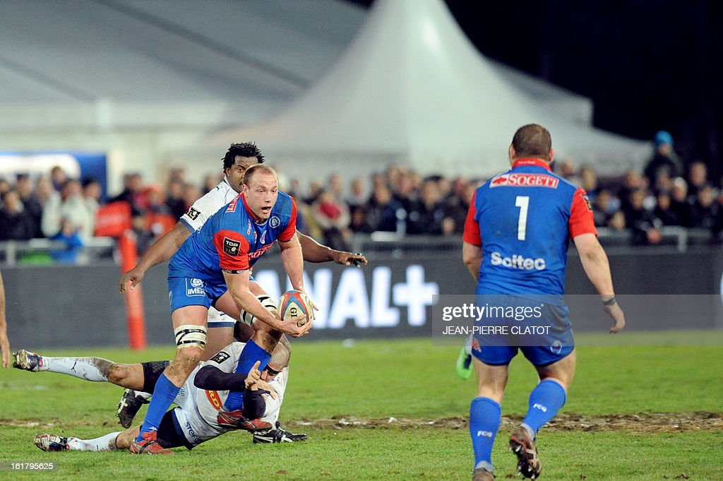 Grenoble's South African lock Naude Beukes (L) clears the ball during the French Top 14 rugby union match Grenoble vs Agen on february 16, 2013 at the Lesdiguieres Stadium in Grenoble, southeastern France.