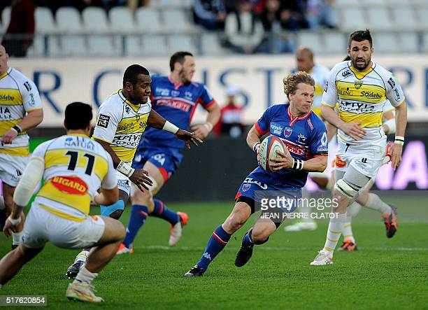 Grenoble's South African scrumhalf Charl Mcleod runs with the ball during the French Top 14 rugby union match Grenoble vs La Rochelle on March 26...
