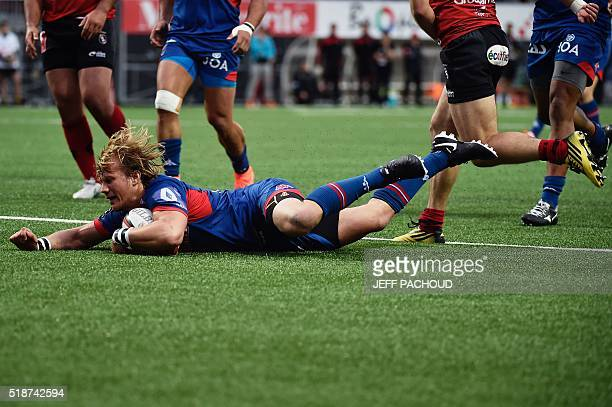 Grenoble's South African scrumhalf Charl Mcleod scores a try during the French Top 14 rugby union match Oyonnax vs Grenoble on April 2 2016 in...