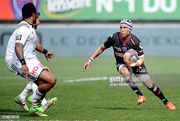 Grenoble's South African wing Gio Aplon runs with the ball during the French Top 14 Rugby Union match between Grenoble and Brive on March 20 2016 at...