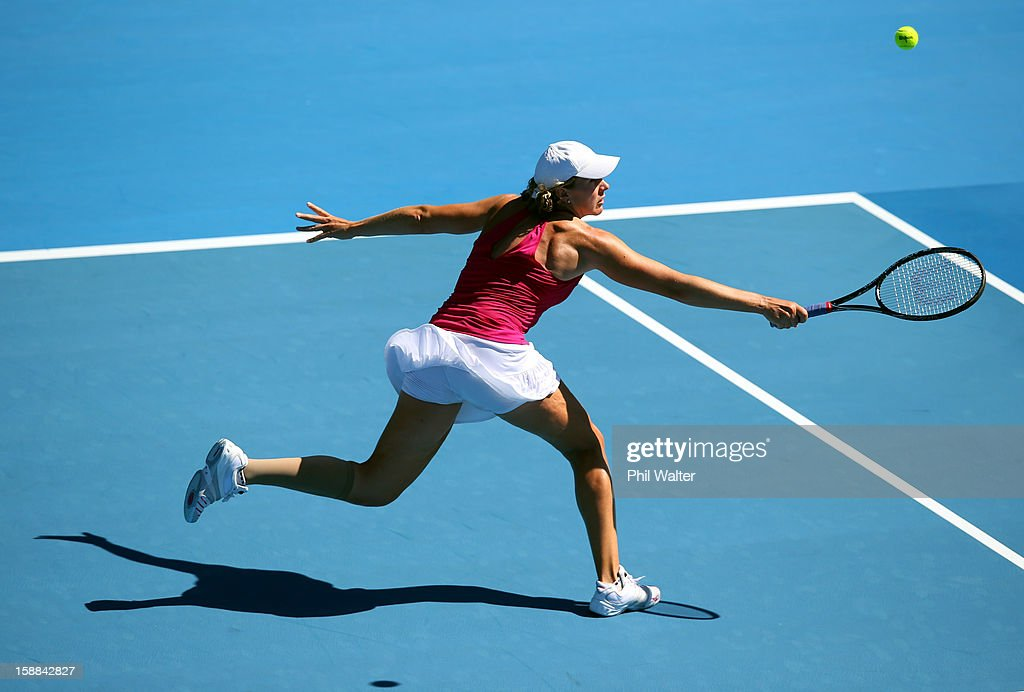 Greta Arn of Hungary plays a backhand in her first round match against Agnieszka Radwanska of Poland during day two of the 2013 ASB Classic on January 1, 2013 in Auckland, New Zealand.
