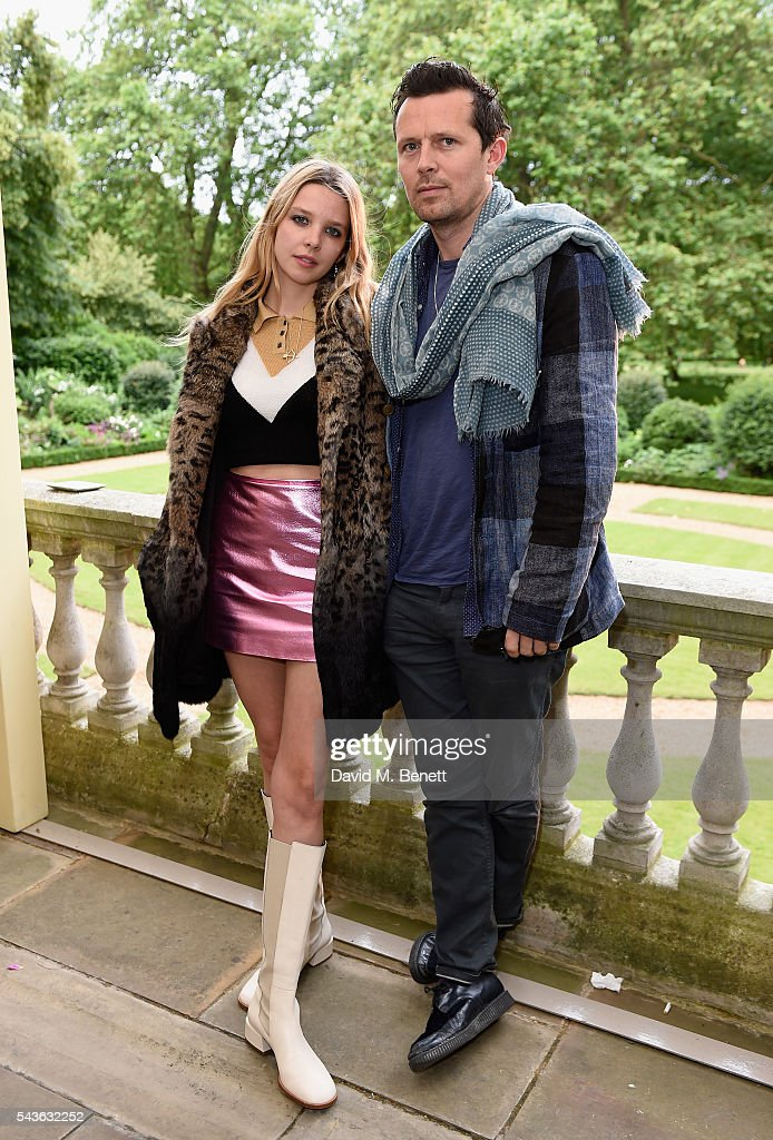 Greta Bellamaccina and Robert Montgomery attend the Creatures of the Wind Resort 2017 collection and runway show presented by Farfetch at Spencer House on June 29, 2016 in London, England.