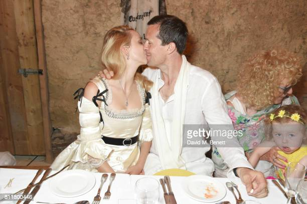Greta Bellamacina and Robert Montgomery kiss at their wedding on July 8 2017 in Exeter England