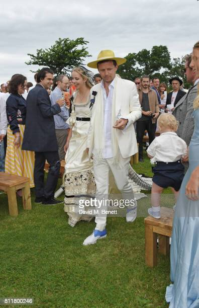 Greta Bellamacina and Robert Montgomery walk down the aisle at their wedding on July 8 2017 in Exeter England