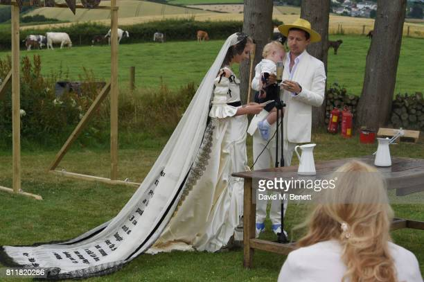 Greta Bellamacina and Robert Montgomery with son Lorca attend their wedding on July 8 2017 in Exeter England